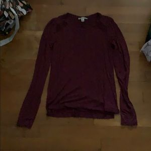 Burgundy long sleeve top with lace accents.